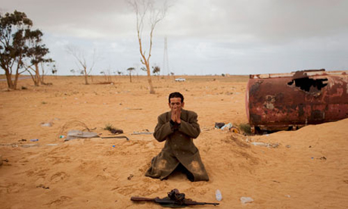 Libyan-rebel-prays-next-007.jpg
